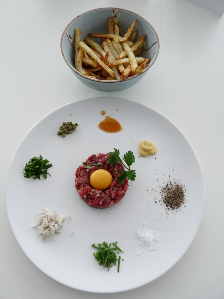 steak tartare, chips and condiments