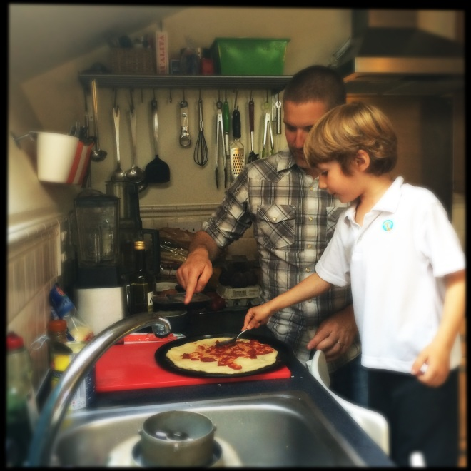 Felix making pizza