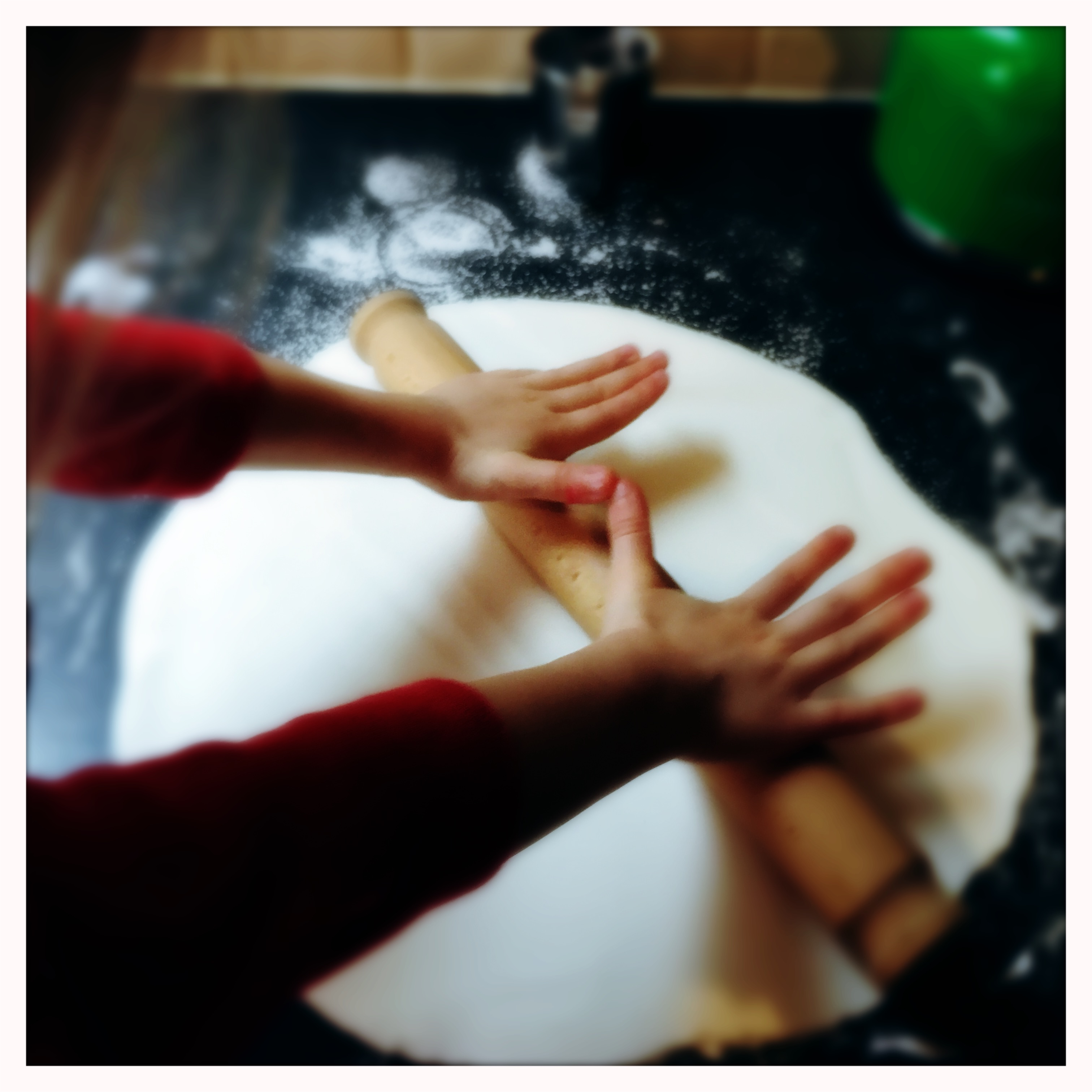 rolling out the icing for the Christmas cake