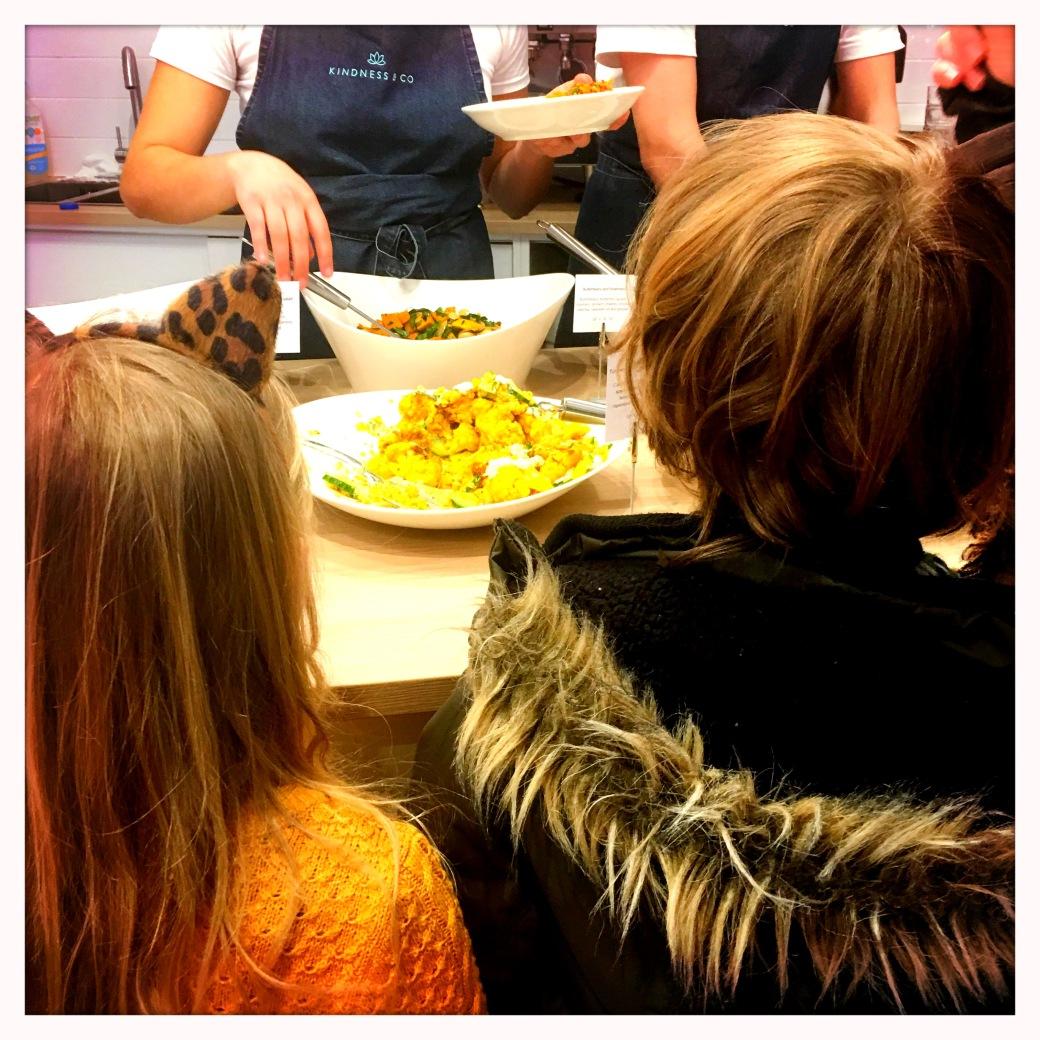 choosing salads at Kindness & Co Cheltenham